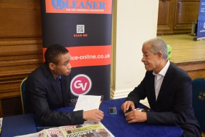 Student talking to Lord Herman Ouseley at REACH SOCIETY